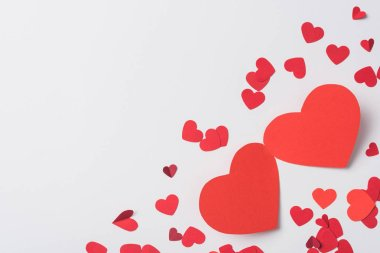 Top view of red hearts on white background stock vector