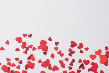 Top view of red hearts scattered on white background stock vector