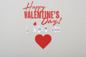 Top view of i love you lettering with paper heart and happy valentines day illustration isolated on grey