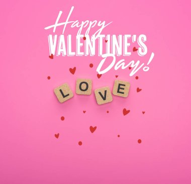 Top view of love lettering on wooden cubes on pink background with happy valentines day illustration stock vector
