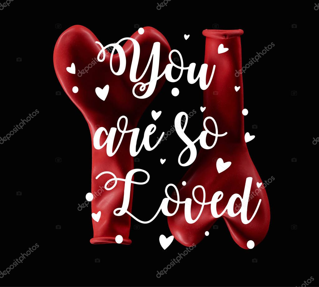 Top view of two red balloons in heart shape isolated on black with you are so loved lettering stock vector