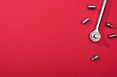 Top view of wrench with nozzles on red background