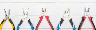 Top view of pliers on white wooden background, panoramic shot stock vector