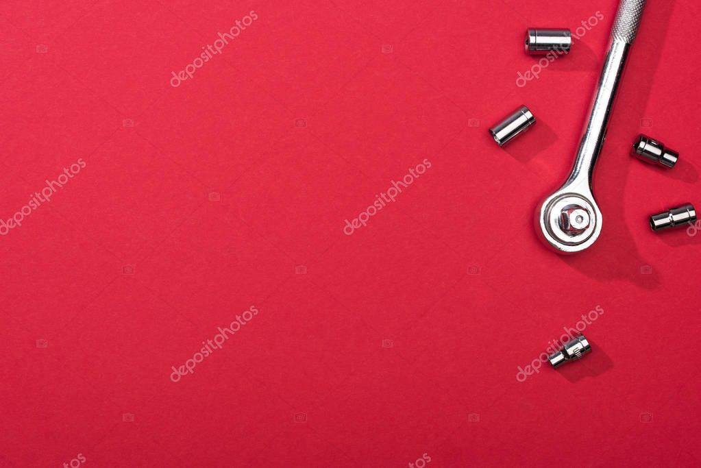 Top view of wrench with nozzles on red background stock vector