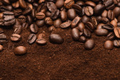 top view of fresh roasted coffee beans and ground coffee