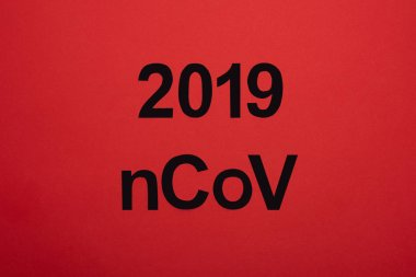 Top view of 2019 ncov lettering isolated on red stock vector