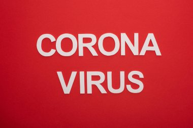 Top view of coronavirus white lettering isolated on red stock vector