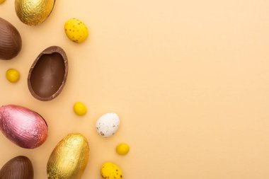 Top view of delicious chocolate and quail eggs with sweets on beige background stock vector