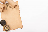 top view of vintage keys and compass on aged paper isolated on white