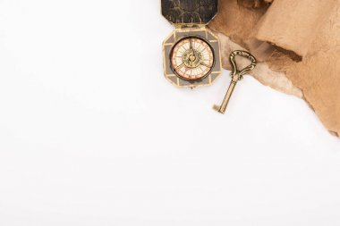 Top view of vintage key, compass and aged paper isolated on white stock vector