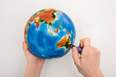 Cropped view of woman setting to fire globe on white, global warming concept stock vector