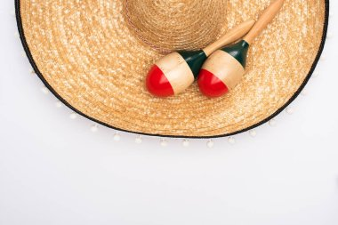 Top view of maracas with sombrero on white background stock vector