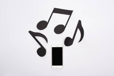 Top view of music paper cut notes and smartphone on white background stock vector