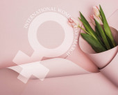 top view of tulips wrapped in paper on pink background, international womens day illustration