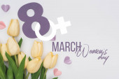 top view of tulips, paper hearts and number 8 isolated on white, international womens day illustration