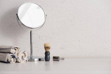 Towels, round mirror, shaving brush and razor on white background, zero waste concept stock vector
