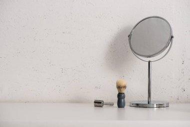 Round mirror, shaving brush and razor on white background, zero waste concept stock vector