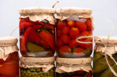 Photo homemade delicious pickles in jars isolated on grey