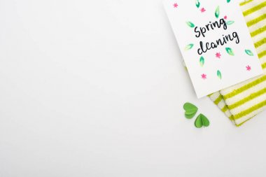 Top view of green rag with hearts near spring cleaning card on white background stock vector