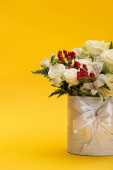 spring fresh bouquet of flowers in festive gift box with bow on yellow