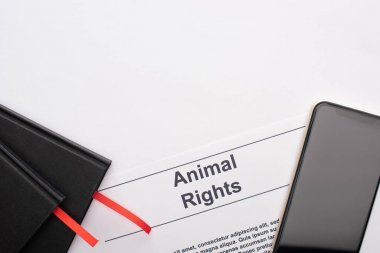 Top view of animal rights inscription, black notebooks and smartphone on white background stock vector