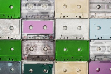 collage of purple, green, turquoise and white old recording cassettes