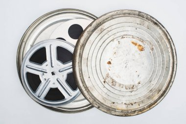 Top view of film reels with tape in rusty tin case on white background stock vector