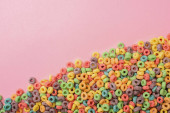 Fotografie top view of bright multicolored breakfast cereal on pink background