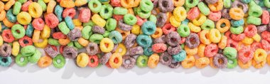 Top view of bright multicolored breakfast cereal on white background, panoramic shot stock vector