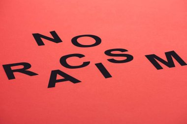 black no racism lettering isolated on red