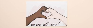 top view of picture with drawn multiethnic hands showing heart gesture on beige background, panoramic shot