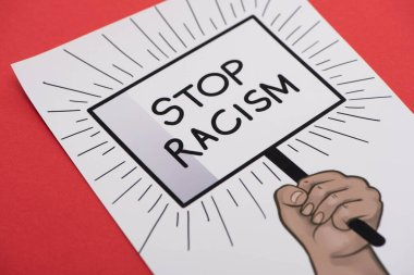 picture with drawn hand and stop racism placard on red background