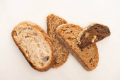 top view of fresh whole grain bread slices on white background