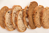 top view of fresh whole wheat bread slices on white background