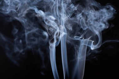 White flowing smoke on black background stock vector
