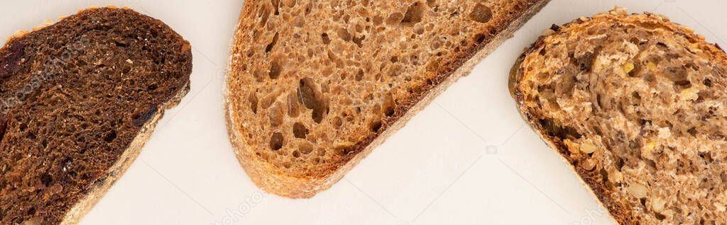Top view of fresh brown bread slices on white background, panoramic shot stock vector