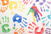 Fotografie top view of colorful handprints on white for World Autism Awareness Day