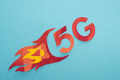 top view of red 5g with flame lettering on blue background