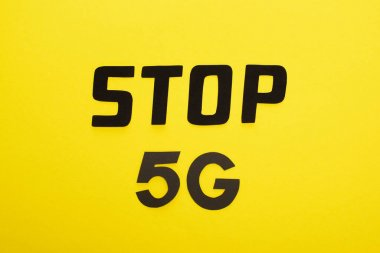 Top view of stop 5g lettering on yellow background stock vector