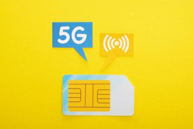 Top view of sim card and speech bubbles with 5g lettering on yellow background stock vector