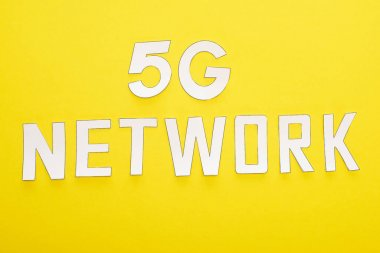Top view of white 5g network lettering on yellow background stock vector