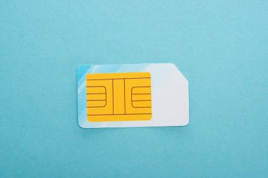 Top view of sim card on blue background stock vector