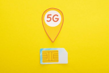 Top view of sim card and 5g lettering on yellow background stock vector