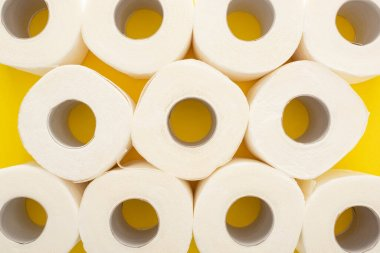 Top view of white toilet paper rolls on yellow background stock vector