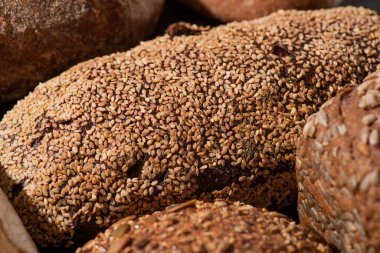 close up view of fresh baked brown whole grain bread