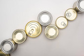 top view of cans with canned food on white background, food donation concept