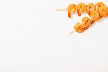 Top view of delicious fried prawns on skewers on white background stock vector