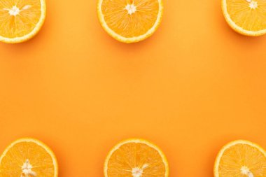 Top view of juicy orange slices on colorful background stock vector
