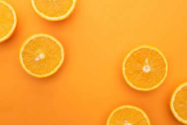 Top view of ripe juicy orange slices on colorful background stock vector