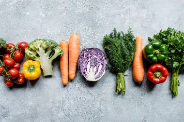 Top view of fresh ripe vegetables on grey concrete surface stock vector